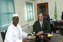 Le président du PMC Arc-en-ciel effectue une visite de courtoisie chez le nouveau directeur général de l'Office National de l'état Civil